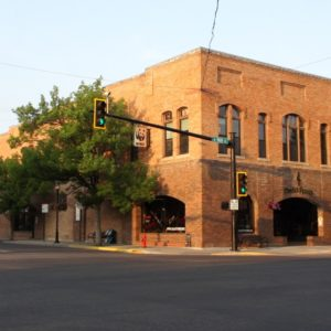 view of downtowner building from downtown main street bozeman montana - ami sayer real estate