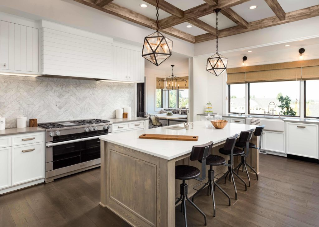 winter home renovation of a modern kitchen with natural accents - ami sayer real estate